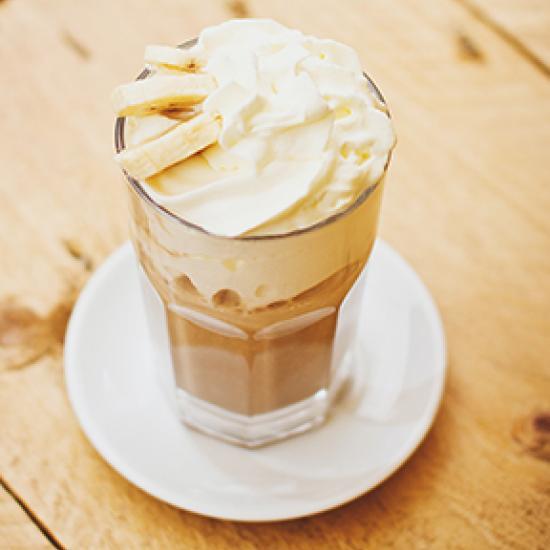 Coffee with cream and banana on top