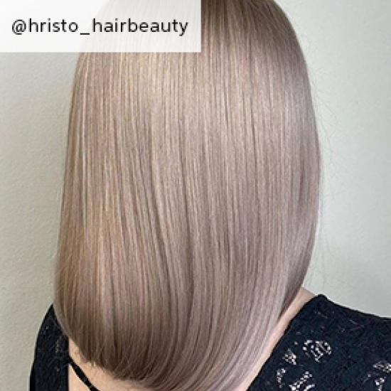 Back of woman's head with dirty blonde hair, created using Wella Professionals.