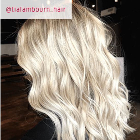 Back of womans head with ice blonde hair, created using Wella Professionals