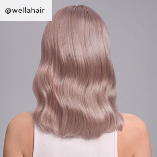 Back of woman's head with mid-length, wavy, lilac blonde hair, created using Wella Professionals.