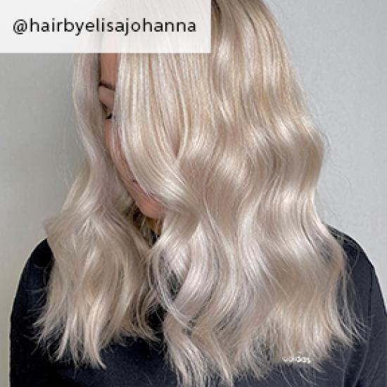Side of wavy mother of pearl hair, created using Wella Professionals