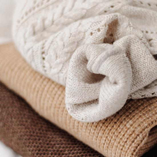 Image of knitted cream jumper