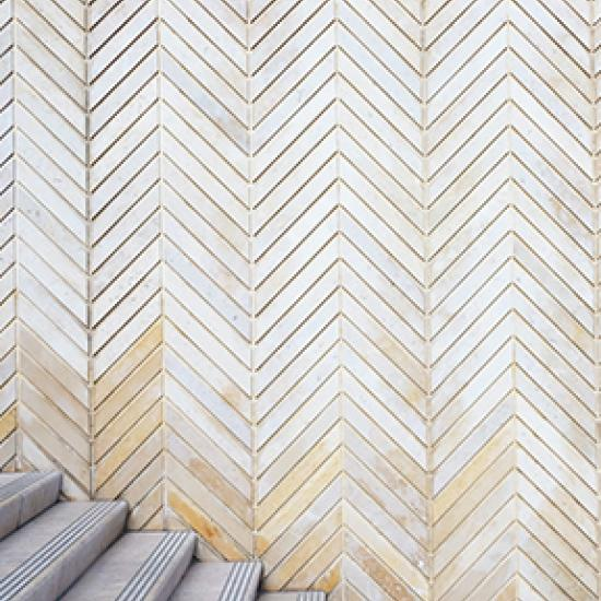 Image of stairs and angled cream tiles