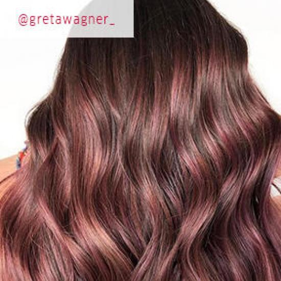 Back of woman's heading showing long, wavy, rose brown hair, created using Wella Professionals.