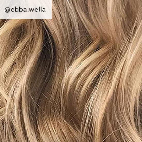 Close-up of sandy blonde, curly hair, created using Wella Professionals.