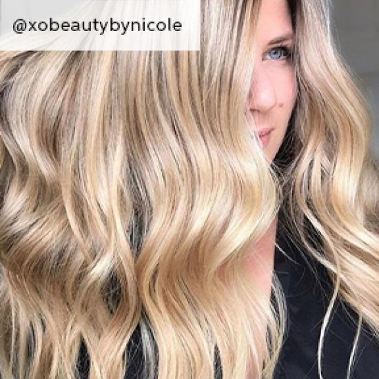 Photo of woman with wavy sandy blonde hair, created using Wella Professionals.