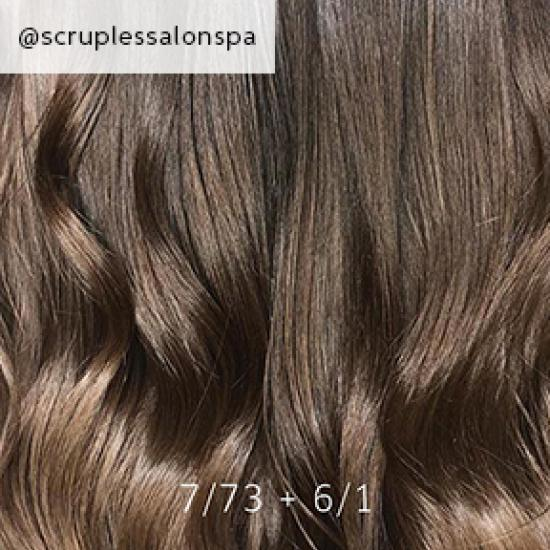 Close-up of dark brown sombre hair, created using Wella Professionals.