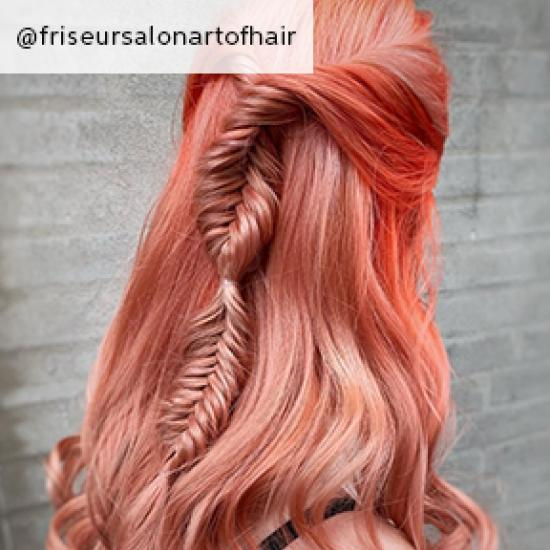 Image of dark pink hair with plait