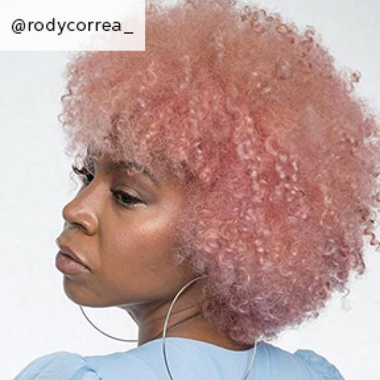 Image of side of short curly cotton candy hair, created using Wella Professionals