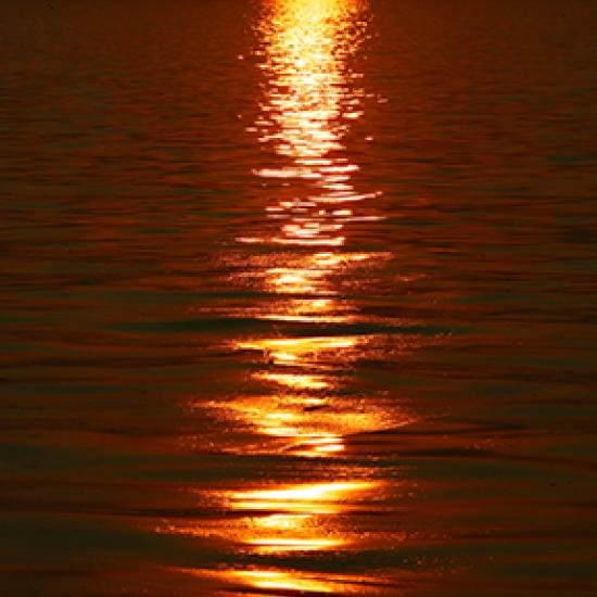 Image of sea with red sun reflection