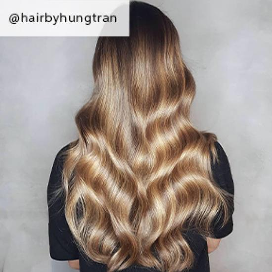 Wavy toffee blonde hair, created using Wella Professionals