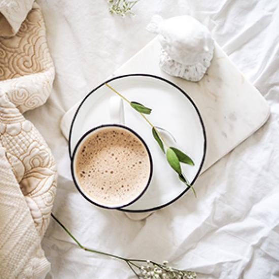 coffee on white bedsheets