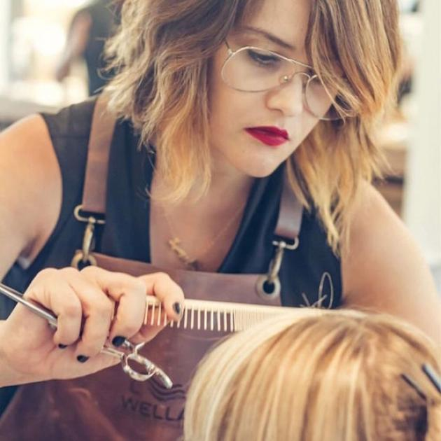 Wella Professionals Passionista Priscilla Gatti cutting a client's hair.