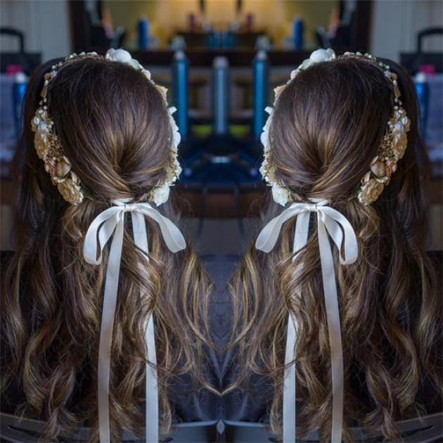 Mirrored image of woman with long chestnut brown hair with New Years Eve hair accessory