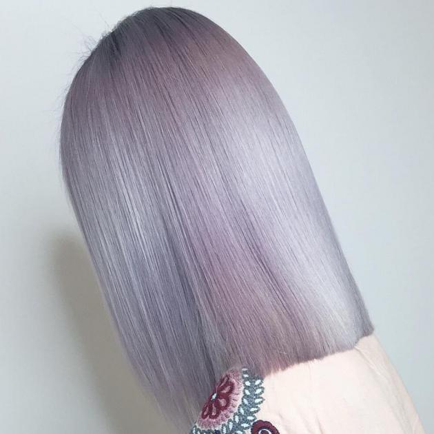 Woman with violet blonde bob