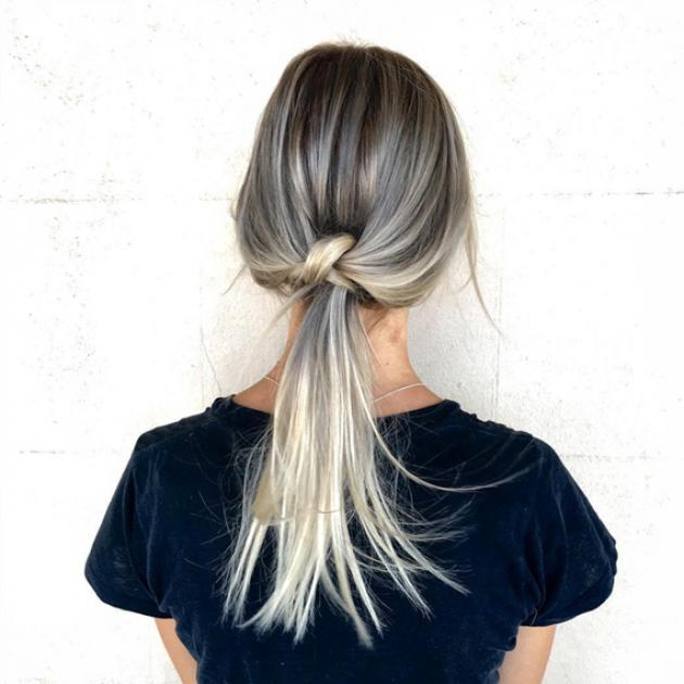 Woman with blonde knot ponytail