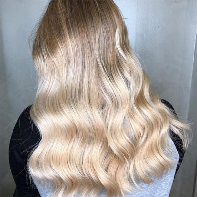 Woman with cool toned blonde wavy hair