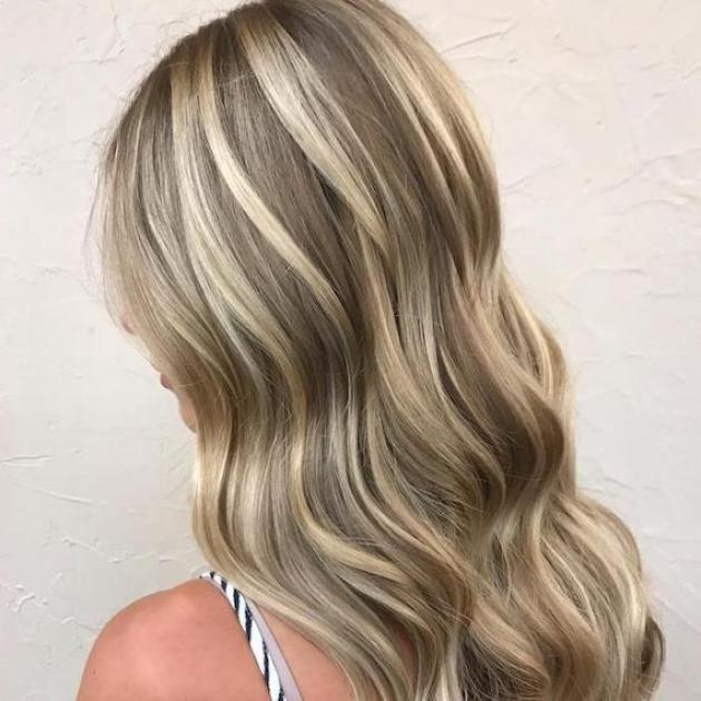 Side profile of woman with champagne blonde frosted hair, created using Wella Professionals.