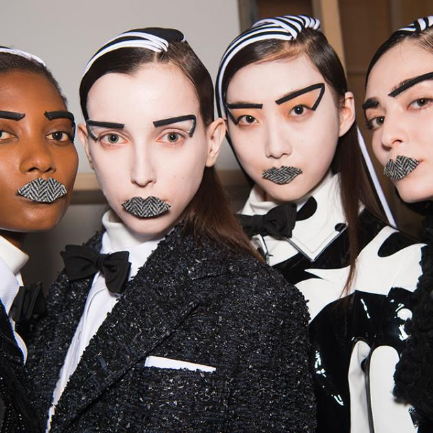 Four models with funky black and white make up
