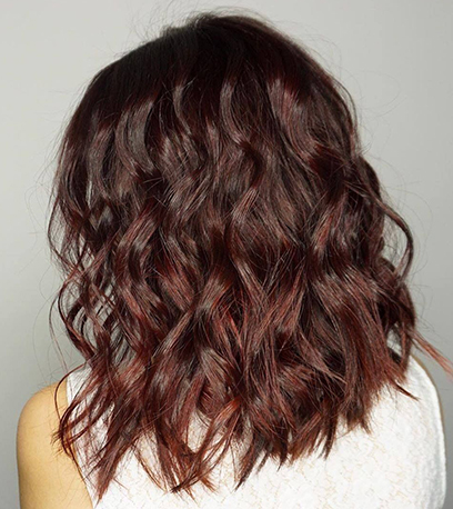 Shimmering mulled wine hair, created using Wella Professionals