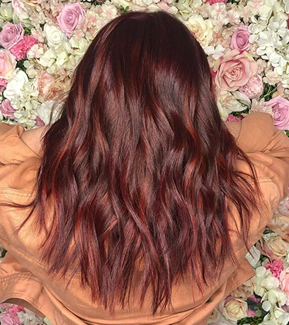 Wavy mulled wine hair, created using Wella Professionals