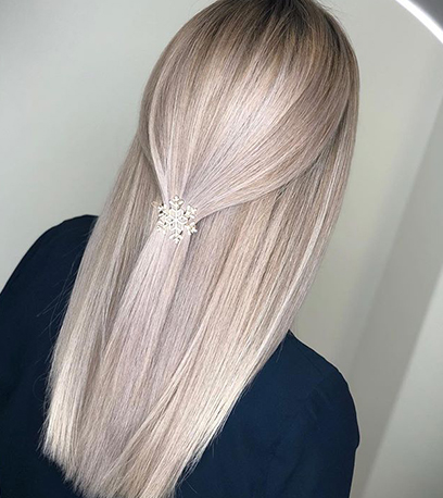 Frosted ash blonde hair, created using Wella Professionals