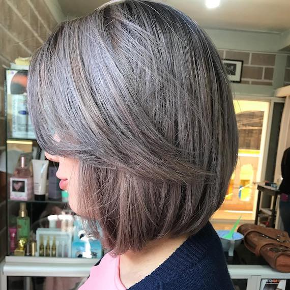 side profile of woman with bob hair with ash accents, created with Wella Professionals