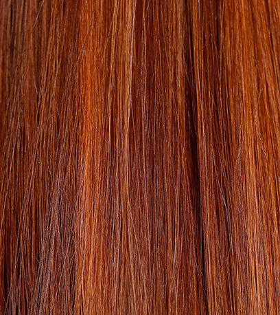 Close-up of vibrant auburn hair, created using Wella Pro-fessionals.