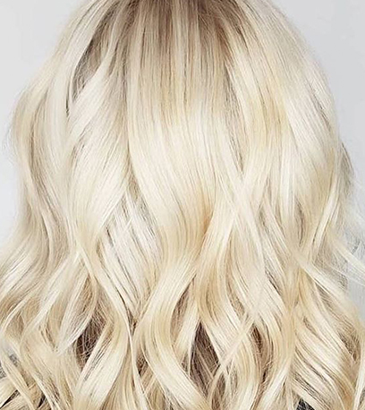 Creamy blonde hair, created using Wella Professionals