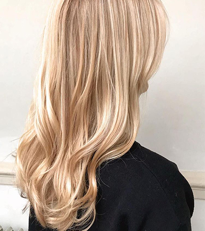 Natural blonde hair, created using Wella Professionals