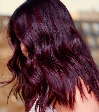 Image of rich black cherry hair, created using Wella professionals