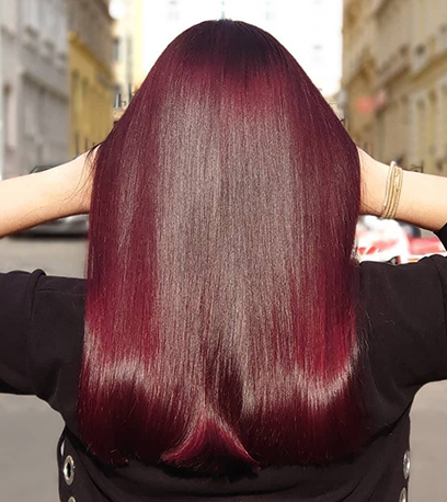 Image of smooth black cherry hair, created using Wella professionals