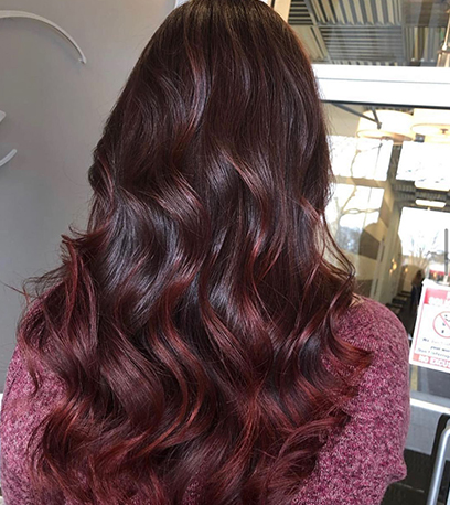 Image of layered black cherry hair, created using Wella professionals