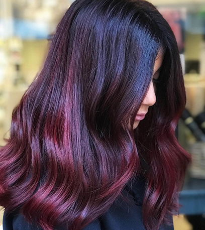 Image of shimmering black cherry hair, created using Wella professionals