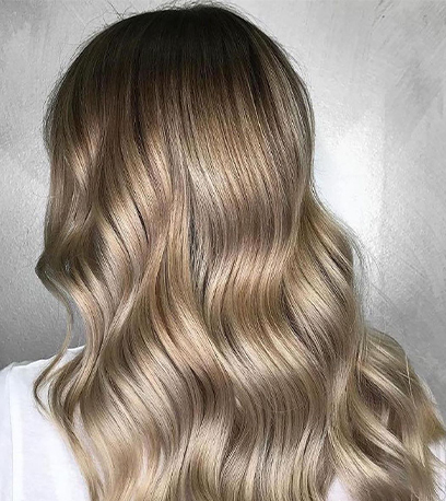 Glossy baby highlights, created using Wella Professionals