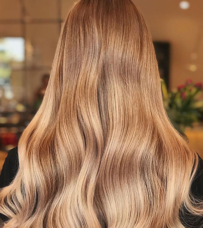 Image of warm butterscotch blonde hair, created using Wella Professionals
