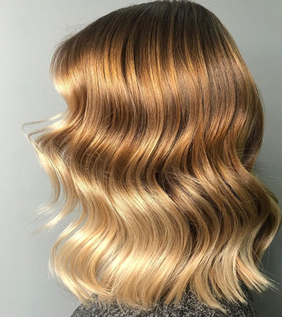 Image of shiny butterscotch blonde hair, created using Wella Professionals