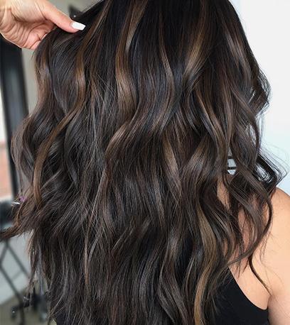 Wavy chilli chocolate hair, created using Wella Professionals