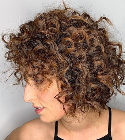 Model with chocolate brown hair created with Magma and Illumina Color
