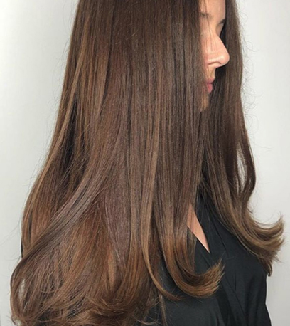 Model with chocolate brown hair created with Color Touch