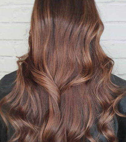 Model with chocolate brown hair created with Illumina Color
