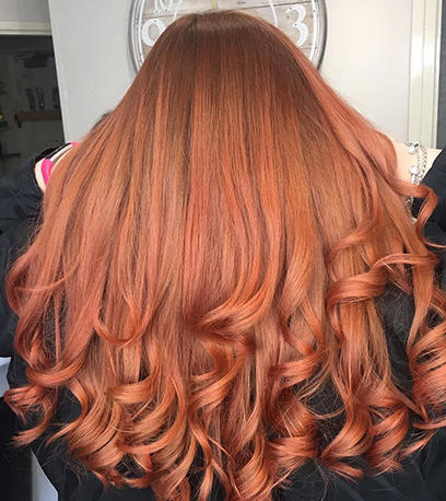 Woman with long wavy copper hair created using Koleston Perfect