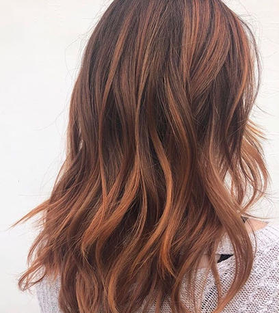 Woman with long wavy darker copper hair leston Perfect