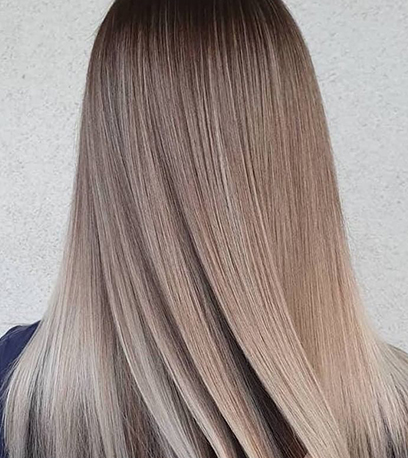 Back of woman's head with long, straight, dark ash blonde hair, created using Wella Profession-als.