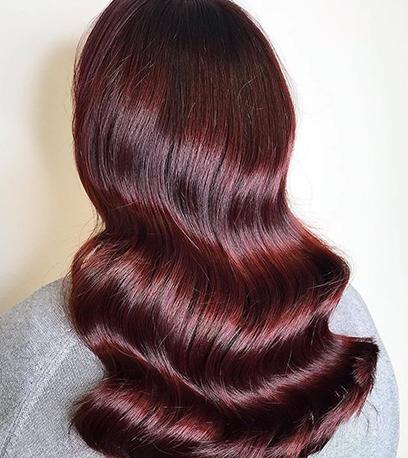 Dark cherry hair, created using Wella Professionals.