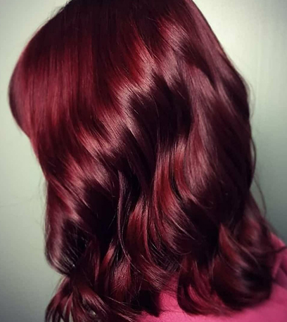 Side profile of mulled wine hair, created using Wella Professionals.