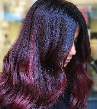 Plum hair, created using Wella Professionals.