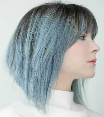 Woman with shoulder-length straight denim blue hair