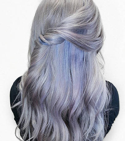 Woman with long wavy denim blue hair created using Color Touch