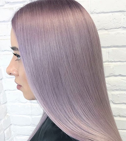 Side profile of woman with long, straight, lilac blonde hair, created using Wella Professionals